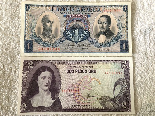 Colombia lot of 2 banknotes (1966 1 peso oro VF and 1976 2 pesos oro UNCIRCULATED)
