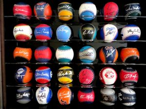 Set of 30 autographed MLB team logo leather baseballs in display case (Ernie Banks Tony Gwynn Willie McCovey Cal Ripken Nolan Ryan Carl Yastrzemski)