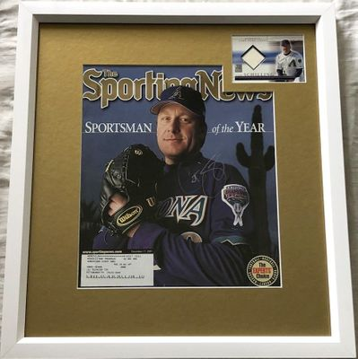 Curt Schilling autographed Arizona Diamondbacks 2001 Sporting News cover framed with game worn jersey card