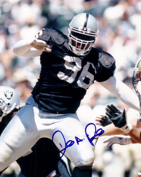 Darrell Russell autographed Oakland Raiders 8x10 photo (Score Board)