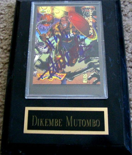 Dikembe Mutombo autographed Denver Nuggets card in plaque