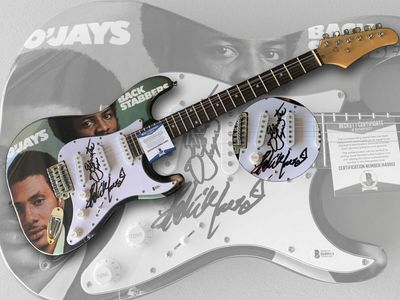 Eddie Levert and Walter Williams autographed The O'Jays electric guitar (BAS authenticated)