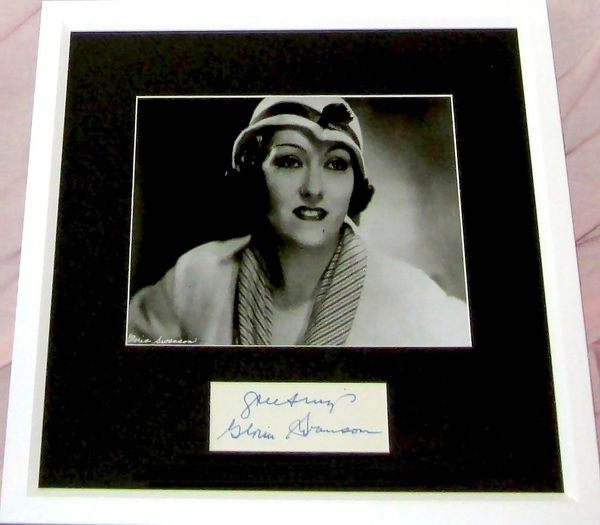 Gloria Swanson autograph matted and framed with 8x10 portrait photo inscribed Greetings