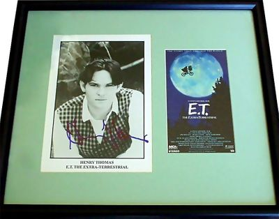 Henry Thomas autographed E.T. 8x10 movie photo matted and framed with movie video box cover