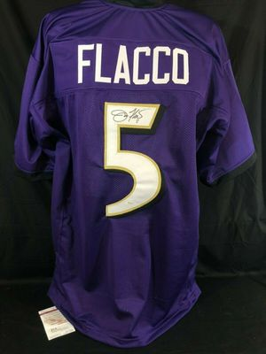 Joe Flacco autographed Baltimore Ravens stitched purple jersey (JSA Witnessed)