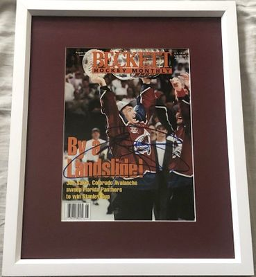 Joe Sakic autographed Colorado Avalanche 1996 Stanley Cup Champions Beckett Hockey cover matted and framed
