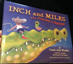 John Wooden autographed Inches and Miles hardcover children's book