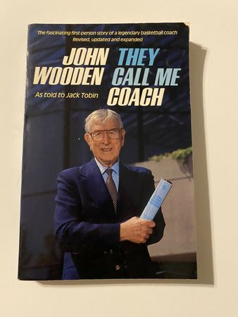 John Wooden autographed They Call Me Coach paperback book