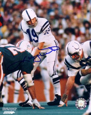 Johnny Unitas autographed Baltimore Colts 8x10 photo (behind center)