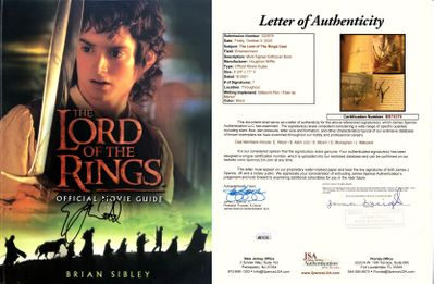 Cast autographed Lord of the Rings movie book Sean Astin Orlando Bloom Dominic Monaghan Elijah Wood (JSA)