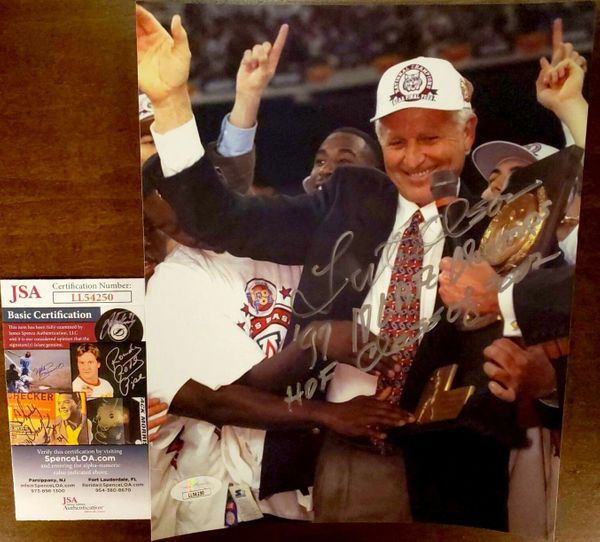 Lute Olson autographed Arizona Wildcats 1997 National Championship 8x10 photo inscribed '97 NCAA Champs HOF Class of 2002 (JSA)