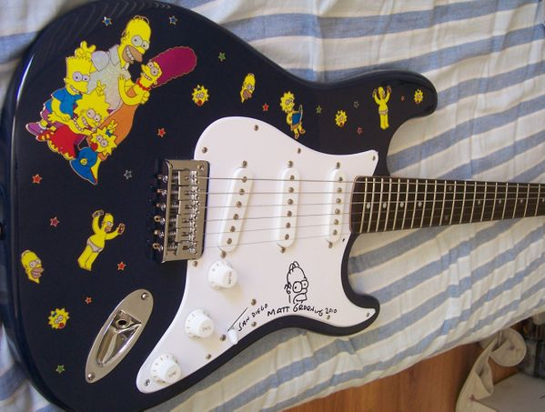 Matt Groening autographed and doodled Simpsons Fender Bullet electric guitar