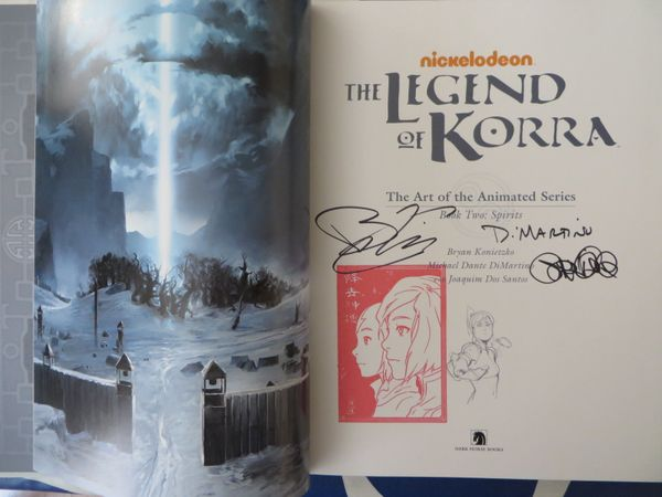 Michael DiMartino and Bryan Konietzko autographed Legend of Korra Art of the Animated Series Book 2 with rare Korra Avatar red stamp