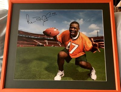 Michael Irvin autographed Miami Hurricanes poster inscribed Playmaker matted and framed