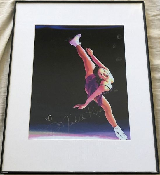 Michelle Kwan autographed skating 8x10 purple dress photo matted and framed (flawed)