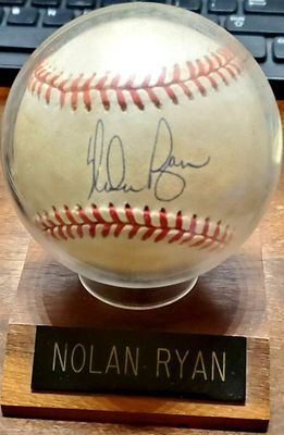 Nolan Ryan autographed Rawlings American League baseball with display stand