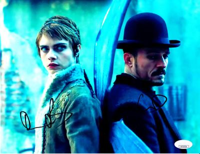 Orlando Bloom and Cara Delevingne autographed Carnival Row 8x11 photo (JSA)