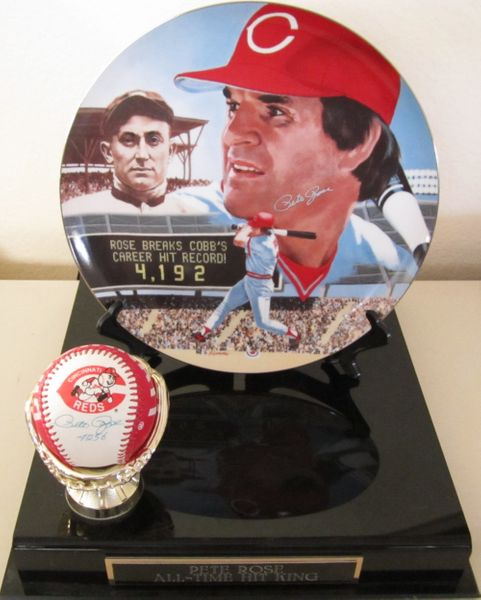 Pete Rose autographed Cincinnati Reds logo baseball and Hit Record commemorative plate with display stand
