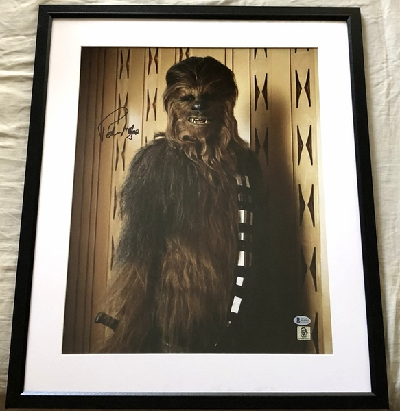 Peter Mayhew autographed Chewbacca Star Wars 16x20 inch poster size movie photo matted and framed (BAS authenticated)