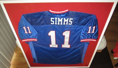 Phil Simms autographed New York Giants stitched blue throwback jersey matted and framed