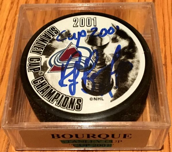 Ray Bourque autographed Colorado Avalanche Stanley Cup Champions puck inscribed Cup 2001 (Mounted Memories)