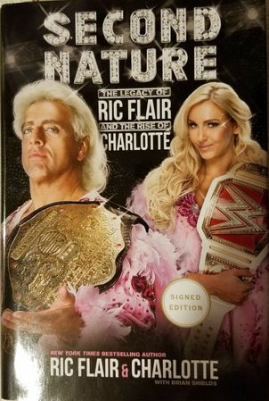 Ric Flair and Charlotte Flair autographed Second Nature hardcover book