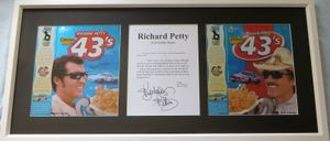 Richard Petty autographed quotation matted & framed with commemorative cereal boxes