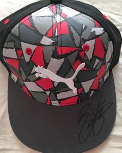 Rickie Fowler autographed gray Puma golf cap or hat
