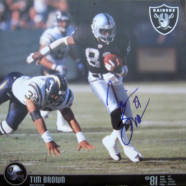 Tim Brown autographed Oakland Raiders 2004 calendar page