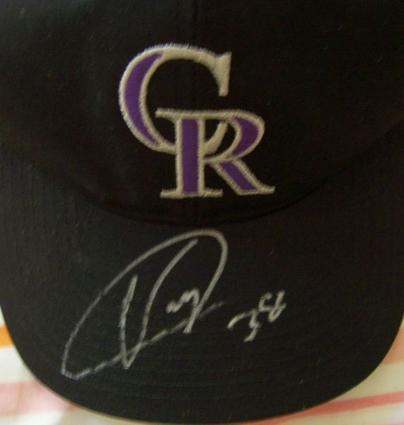 Ubaldo Jimenez autographed Colorado Rockies cap or hat