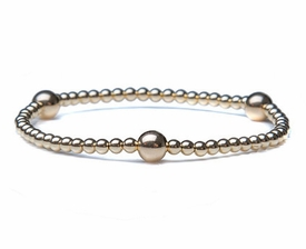 14k gold bracelet with 3 accent balls and beads