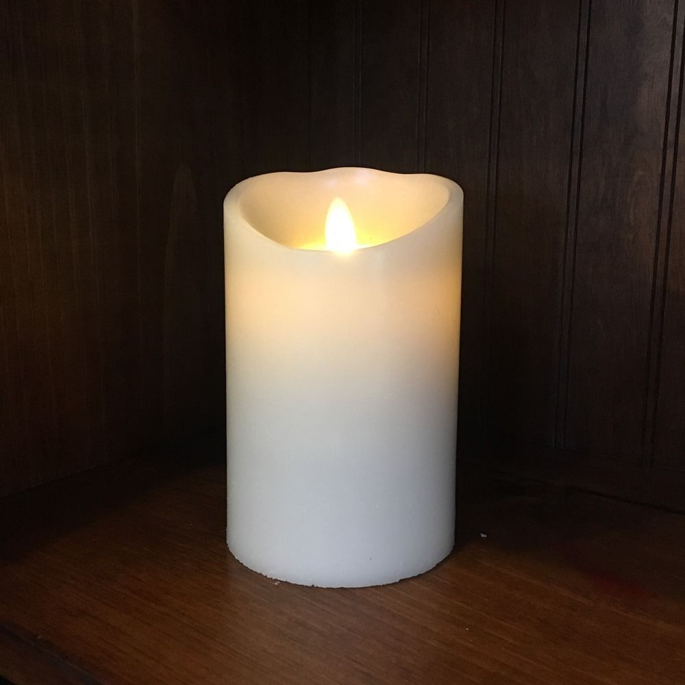 Battery operated pillar candle moving flame led candle ivory 5 5in x 3 5
