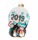 Christopher Radko Holding Up 2019 Penguin Ornament