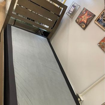 Floor Model Twin grey bed with a box spring