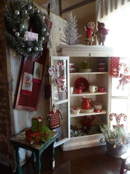 A small cabinet gets dressed for the holidays and could easily dispense those last minute gifts for neighbors and guests. As the sign says, a great way to avoid getting your tinsel in a tangle!