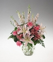 A clear vase arrangement of pink and white flowers