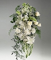 Arrangement of mixed white flowers on an easel.
