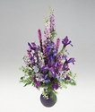 Blue and purple flowers in a vase