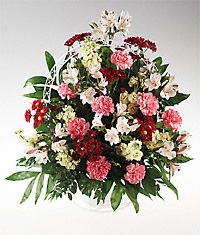 Mixed flower in a handled basket sympathy