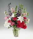 Mixed garden flowers in a clear vase.