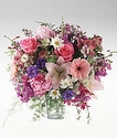 Soft colors of mixed flowers in a vase arrangement.