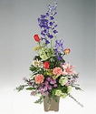 Sympathy arrangement in vivid colors.
