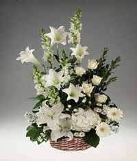 Sympathy Basket arrangement of mixed white flowers.