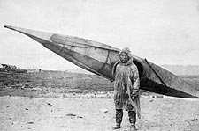 Eskimo Carrying Kayak Nome, Alaska Photo Print for Sale
