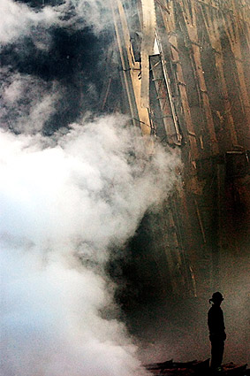 Fire Fighter with Rubble and Smoke 9/11 NYC Photo Print
