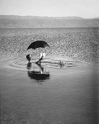 Man Floats in Dead Sea w/ Book & Umbrella Photo Print