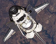 NASA Space Shuttle Discovery in Orbit Photo Print for Sale