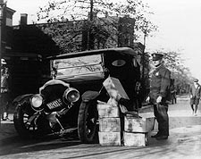 Policeman with Wrecked Car and Cases of Moonshine Photo Print for Sale