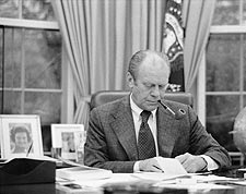 President Ford Smokes Pipe at Desk in Oval Office Photo Print for Sale