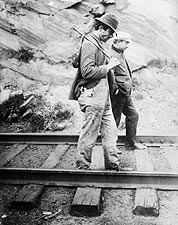 Traveling Hikers Tramp on a Railroad Track Photo Print for Sale